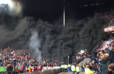 Man arrested as black smoke engulfs stands at PSV-Ajax clash