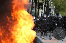 Protesters hurl cans of Pepsi at police during US May Day riots