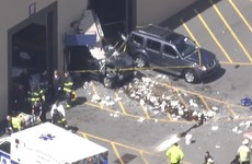 Multiple injuries reported after SUV drives into crowd at US car auction