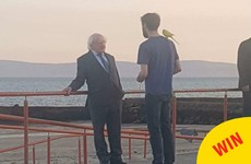 Michael D chatting to a man with a budgie on his shoulder is one of the great Galway photos