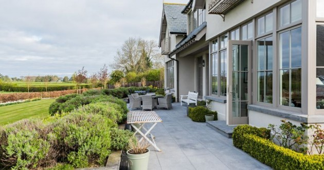 This magnificent home has a tennis court and room for horses - less than an hour from Dublin