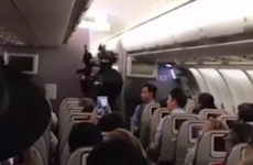 Man who threatened to 'blow up' plane is wrestled to the floor by passengers