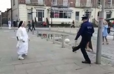 A garda and a nun playing a game of keepie-uppies is the most Limerick thing to ever happen