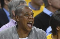 Jay Z has been caught rapid awkwardly fake laughing for photos