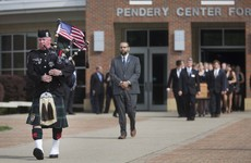 Bagpiper plays 'Going Home' as US student who was detained in North Korea laid to rest