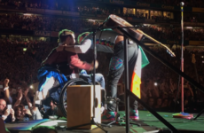Coldplay brought a crowd-surfing Irish fan in a wheelchair on stage to perform with them in Croke Park