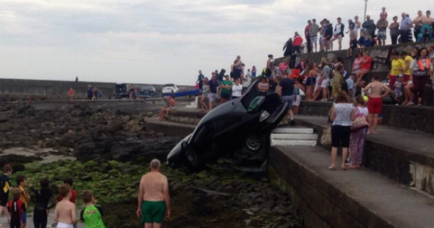 'Runaway' car rolls down steps towards the sea at Kilkee beach