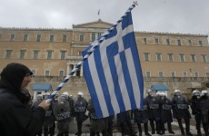 Greece leaders reach deal on more austerity and cuts