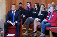 A photo of 3 women in Repeal jumpers defiantly sitting behind Leo Varadkar in Belfast has gone viral