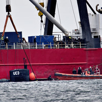 Danish police search homemade submarine but don't find body of missing journalist