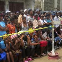 Sierra Leone mudslide: Mass burials begin as at least 100 dead identified as children