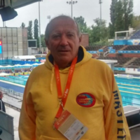 Spanish swimmer stays on blocks to observe minute's silence for attack victims