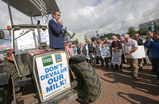 Farmers gather outside supermarkets in protest at low milk prices