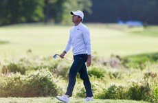 Frustrated Rory McIlroy misses the cut as newcomer Rahm leads in Boston