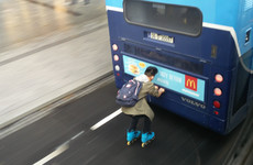 'Bus drivers were beeping wildly': Video captures rollerblader hitching ride on back of Dublin Bus