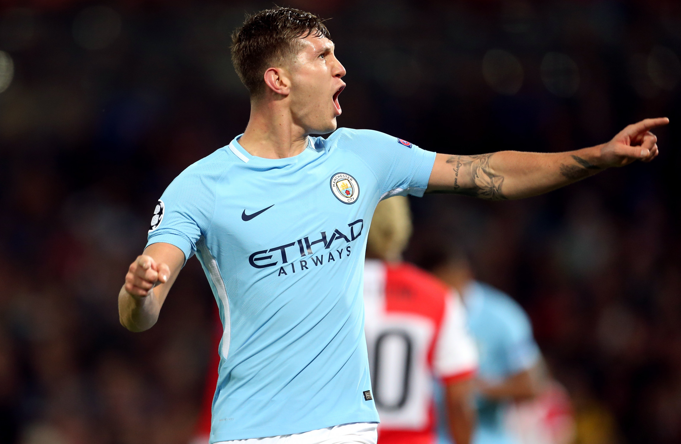 Manchester City's John Stones celebrates scoring his side's fourth goal of the game.                     Image Steven Paston