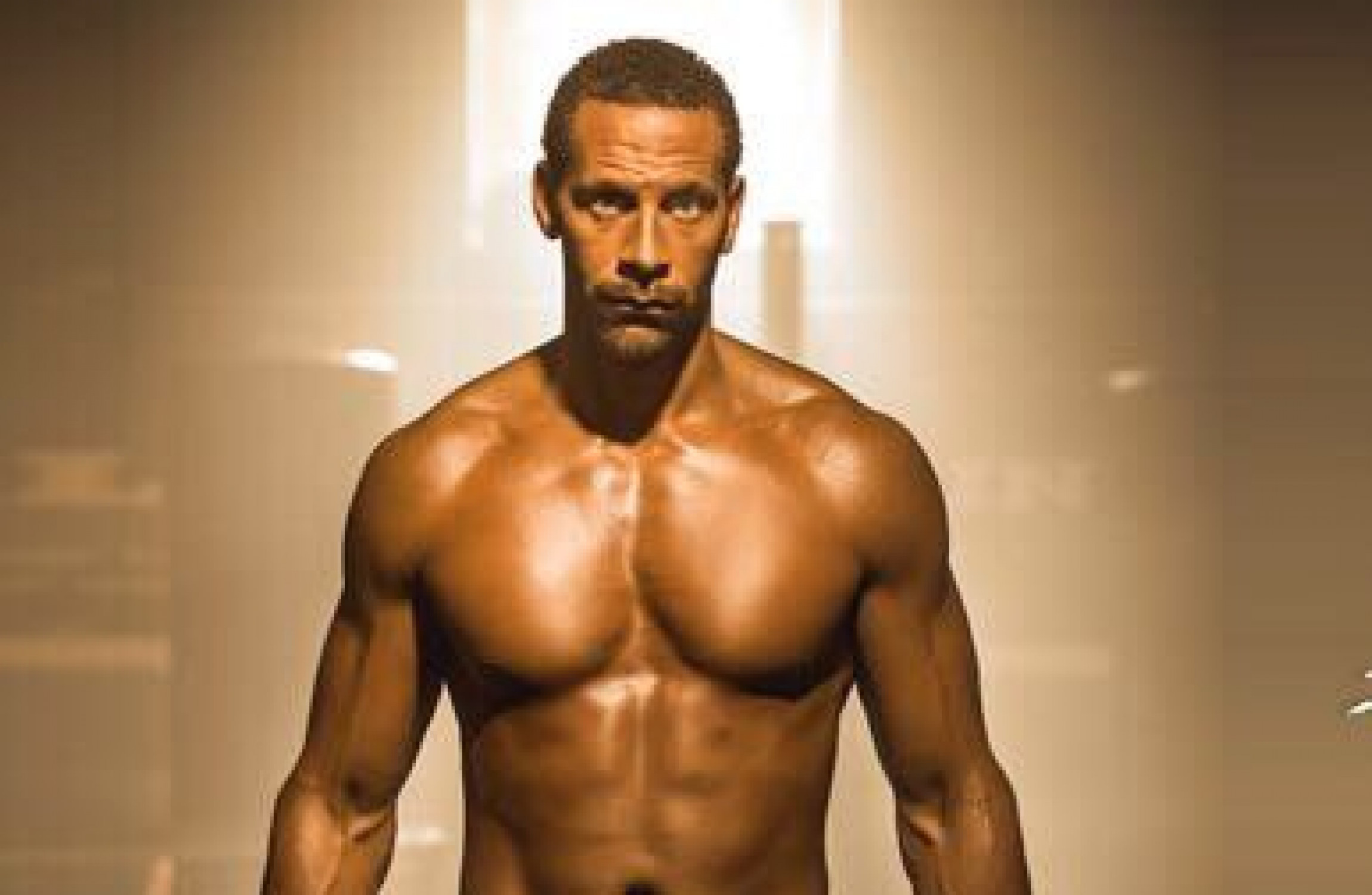 Rio Ferdinand definitely looks the part in first image as professional boxer