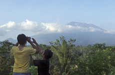 Thousands evacuate Bali as smoke spews from volcano for first time in 50 years