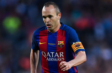 Iniesta ends speculation by signing 'lifetime contract' with Barcelona