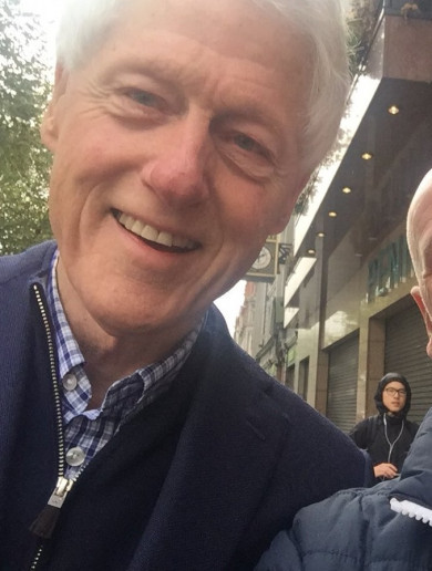 Bill Clinton is roaming the streets of Dublin in the storm like an absolute rebel