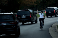 This picture of a cyclist giving Trump's motorcade the finger is going super viral