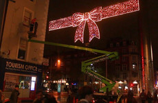 Beginning to look a lot like Christmas - watch the Christmas lights go up on Henry Street