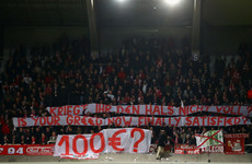 Uefa investigating Bayern after fans throw fake money in protest over Champions League prices