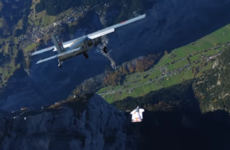 Wingsuit flyers pull off outrageous stunt by BASE jumping right into a moving plane