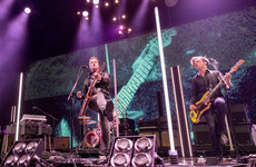 Queens of the Stone Age frontman under fire for kicking photographer during gig
