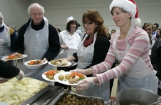 Volunteers will feed 3,500 poor and homeless people a Christmas dinner today