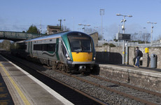 A passenger called 'a liar' by an inspector has settled a defamation case against Irish Rail