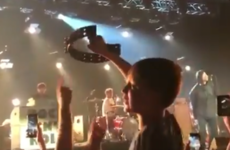 Liam Gallagher made a young fan's night by giving him a tambourine during a performance of Wonderwall