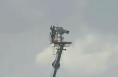 WATCH: Wayward drive improbably hits cameraman