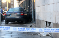 Occupants of car flee scene after crashing into government office building