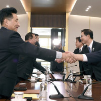 Hand of friendship: North and South Korea will compete together at the Winter Olympics