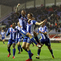 Third-tier Wigan stun Bournemouth as Swansea also progress in FA Cup