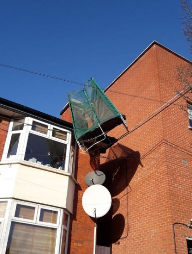 A trampoline was blown onto power cables above a house in Dublin today