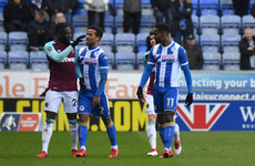 West Ham's Masuaku sent off for spitting as Will Grigg-inspired Wigan cause FA Cup upset