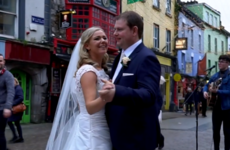 A newly-married couple had their first dance along to a busker on Shop Street