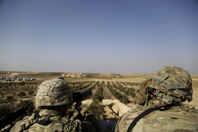 American troops look out toward the border with Turkey from a small outpost.