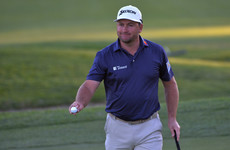 Graeme McDowell tied for the lead at Riviera while Tiger Woods misses cut