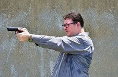 Australian politician in hot water for posting photo with gun in wake of Florida mass shooting