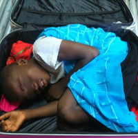 Father goes on trial in Spain in case of 8-year-old found in suitcase at border crossing