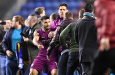Wigan to investigate pitch invasion after win over Manchester City