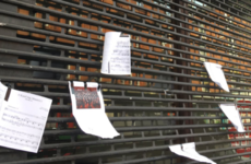 People are hanging sheet music on Waltons' shutters after its closure on Monday