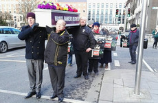 Protesters deliver a coffin to the door of PTSB, as government agrees to regulate vulture funds