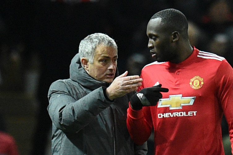 Romelu Lukaku in conversation with Jose Mourinho.