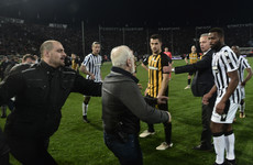 Greek police issue warrant after soccer club owner invades pitch with gun during match