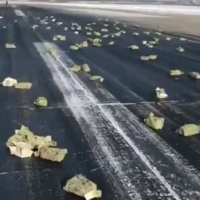Over �300 million worth of gold spilled onto a Russian runway after a cargo plane shed its load