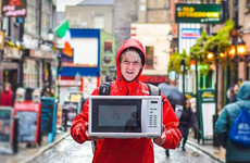 A DIT student is hitch-hiking through all 32 counties carrying a microwave for a really good cause